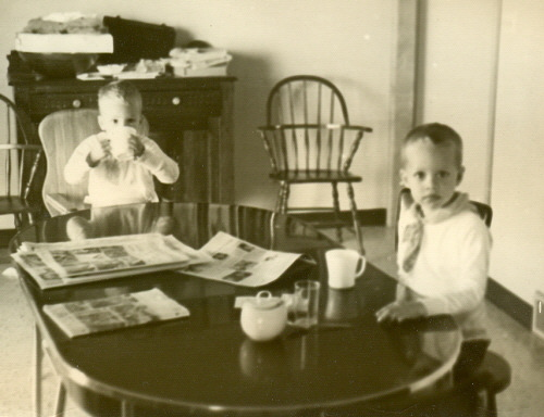 Nate and Kier at breakfast table at grandparents' house in Greenville, Ohio